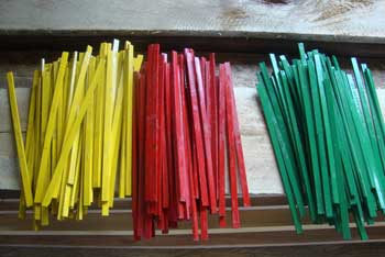Piles of yellow, red and green Sticks
