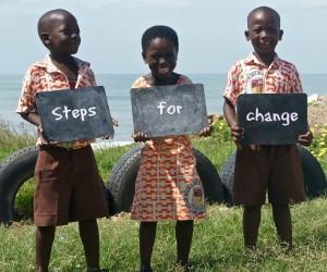 children holding steps for change sign