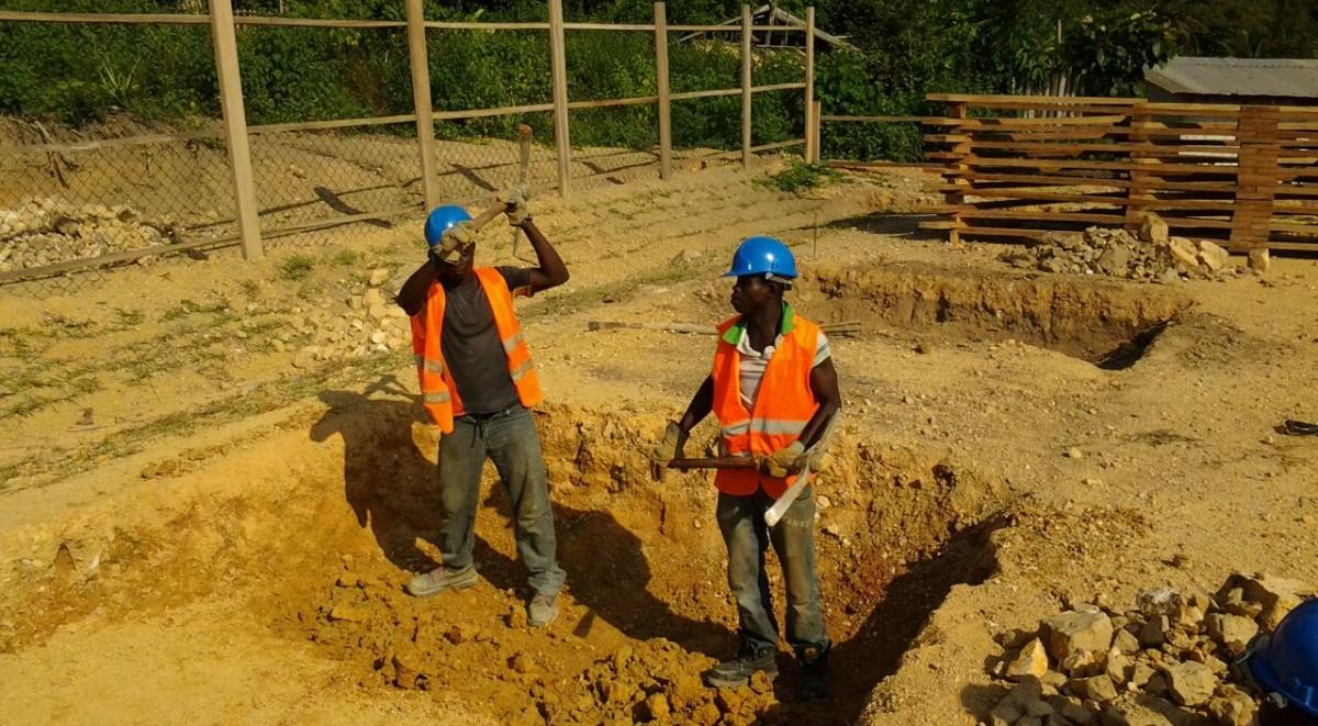 image: digging latrine pit