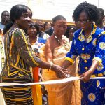 Image: cutting the ribbon at holy child opening