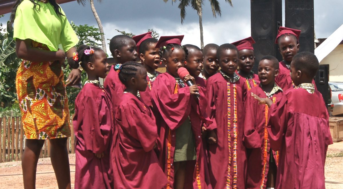 image: children performing at holy child opening